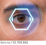 Concept of sensor implanted into human eye. Стоковое фото, фотограф Elnur / Фотобанк Лори