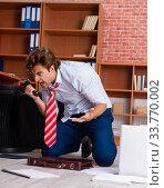 Unhappy businessman sitting in the office. Стоковое фото, фотограф Elnur / Фотобанк Лори