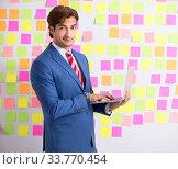 Купить «Young handsome man in conflicting priorities concept», фото № 33770454, снято 17 августа 2018 г. (c) Elnur / Фотобанк Лори