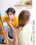 Купить «Young couple enjoying painting at home», фото № 33771394, снято 11 июля 2018 г. (c) Elnur / Фотобанк Лори