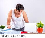 Купить «Young man freelancer ironing in the bedroom», фото № 33771694, снято 27 июня 2018 г. (c) Elnur / Фотобанк Лори