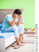 Man suffering from sleeping disorder and insomnia. Стоковое фото, фотограф Elnur / Фотобанк Лори