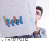 Купить «Businessman looking at financial charts and graphs», фото № 33772382, снято 9 сентября 2017 г. (c) Elnur / Фотобанк Лори
