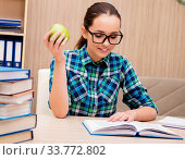 Young female student preparing for exams. Стоковое фото, фотограф Elnur / Фотобанк Лори
