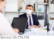 Office workers in protective medical masks. Стоковое фото, фотограф Яков Филимонов / Фотобанк Лори