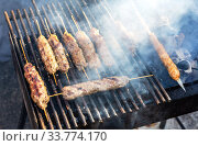 Купить «Oriental turkish kebap and shashlik skewer», фото № 33774170, снято 5 октября 2019 г. (c) FotograFF / Фотобанк Лори