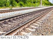 Купить «Double track electrified railway line», фото № 33774270, снято 6 июля 2019 г. (c) FotograFF / Фотобанк Лори