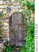 Rough old wooden door with forged metal elements. Стоковое фото, фотограф FotograFF / Фотобанк Лори