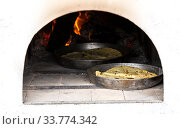 Купить «Cooking traditional pies in a Russian oven», фото № 33774342, снято 4 октября 2019 г. (c) FotograFF / Фотобанк Лори