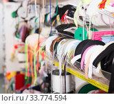 Купить «Colored ribbons on needlework store shelves», фото № 33774594, снято 18 октября 2019 г. (c) Яков Филимонов / Фотобанк Лори