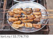 Edible palm weevil larvae , fried on fi. Стоковое фото, фотограф Gagara / Фотобанк Лори