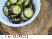 Купить «in a bowl, raw, struck eggplant in a marinade with herbs, dill in a rustic natural form. Preparation for grilling. View from above.», фото № 33775762, снято 13 августа 2018 г. (c) Tetiana Chugunova / Фотобанк Лори