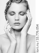 Купить «Black and white portrait in high key tone female with creative hairdo braids», фото № 33776054, снято 30 января 2012 г. (c) Serg Zastavkin / Фотобанк Лори
