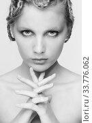 Купить «Black and white portrait in high key tone female with creative hairdo braids», фото № 33776062, снято 30 января 2012 г. (c) Serg Zastavkin / Фотобанк Лори