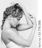Купить «Black and white portrait in high key tone female with creative hairdo braids», фото № 33776086, снято 30 января 2012 г. (c) Serg Zastavkin / Фотобанк Лори
