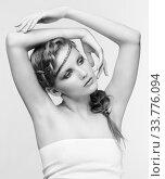 Купить «Black and white portrait in high key tone female with creative hairdo braids», фото № 33776094, снято 30 января 2012 г. (c) Serg Zastavkin / Фотобанк Лори