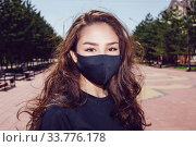 Portrait of a young woman in black face mask. Стоковое фото, фотограф Женя Канашкин / Фотобанк Лори
