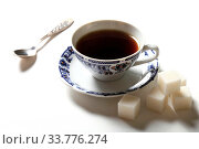 Купить «Cup of coffee and pieces of sugar on a white background», фото № 33776274, снято 7 мая 2020 г. (c) Яна Королёва / Фотобанк Лори