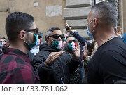Protest of the tricolor masks: casapound, merchants, VAT number, against government measures for the economic crisis due to the Covid-19 pandemic. A group... Редакционное фото, фотограф Fotia/AGF/Francesco Fotia / age Fotostock / Фотобанк Лори