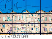 Купить «Crooked reflection of houses in the glass of the window abstract colored background», фото № 33781998, снято 31 мая 2020 г. (c) easy Fotostock / Фотобанк Лори
