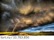 Купить «Storm Clouds Canada warning ominous skies Saskatchewan», фото № 33783850, снято 2 июня 2020 г. (c) age Fotostock / Фотобанк Лори