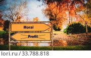 Купить «Street Sign the Direction Way to Moral versus Profit», фото № 33788818, снято 5 июля 2020 г. (c) easy Fotostock / Фотобанк Лори