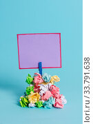Купить «Reminder pile colored crumpled paper clothespin reminder blue background», фото № 33791638, снято 16 июля 2020 г. (c) easy Fotostock / Фотобанк Лори