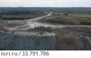 Aerial video of mining rock dumps in Siberia, Russia. Стоковое видео, видеограф Serg Zastavkin / Фотобанк Лори