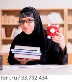 Купить «The muslim girl in hijab studying preparing for exams», фото № 33792434, снято 27 мая 2020 г. (c) easy Fotostock / Фотобанк Лори