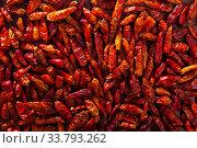 Купить «Closeup of dried cayenne peppers», фото № 33793262, снято 25 мая 2020 г. (c) Яков Филимонов / Фотобанк Лори