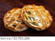 Купить «Puff pastries with spinach and goat cheese on wooden surface», фото № 33793266, снято 27 мая 2020 г. (c) Яков Филимонов / Фотобанк Лори