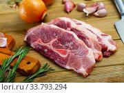 Купить «Raw pork's fillet shoulder with rosemary and garlic», фото № 33793294, снято 30 мая 2020 г. (c) Яков Филимонов / Фотобанк Лори