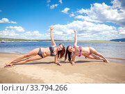 Two young beautiful women doing gymnastics in their arms on the beach on a sunny summer day. Стоковое фото, фотограф Акиньшин Владимир / Фотобанк Лори