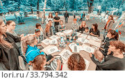 "Russia, Samara, July 2017: Master class on sketching on the embankment at the festival ""Volgafest"" on a summer day. Text in Russian: happiness, flies away. Редакционное фото, фотограф Акиньшин Владимир / Фотобанк Лори"