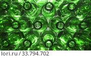 Empty bottles. Slider shot of empty glass bottles. Top view in production line. Empty green beer bottles, the top view ,Dolly shot. Стоковое видео, видеограф Куликов Константин / Фотобанк Лори