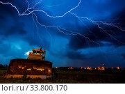 Купить «Yellow tractor on dramtic sky background», фото № 33800170, снято 2 июня 2020 г. (c) easy Fotostock / Фотобанк Лори