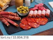 Купить «Meat platter on slate board», фото № 33804318, снято 14 июля 2020 г. (c) Яков Филимонов / Фотобанк Лори