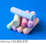 Childrens colored crayons for drawing on a blue background. Стоковое фото, фотограф Володина Ольга / Фотобанк Лори