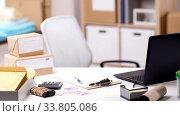 Купить «laptop and parcels on table at post office», видеоролик № 33805086, снято 27 мая 2020 г. (c) Syda Productions / Фотобанк Лори