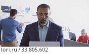 Купить «Businessman working in modern office», видеоролик № 33805602, снято 12 октября 2019 г. (c) Wavebreak Media / Фотобанк Лори