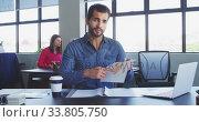 Купить «Businessman interviewing someone in modern office», видеоролик № 33805750, снято 12 октября 2019 г. (c) Wavebreak Media / Фотобанк Лори