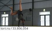Купить «Female gymnast performing at sports hall», видеоролик № 33806054, снято 17 сентября 2019 г. (c) Wavebreak Media / Фотобанк Лори