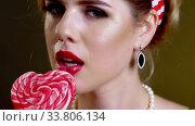 Woman retro style lick lollipop confection and saxy flirting. Стоковое видео, видеограф Gennadiy Poznyakov / Фотобанк Лори