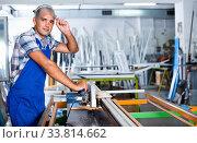 Confident workman ready to working on circular saw. Стоковое фото, фотограф Яков Филимонов / Фотобанк Лори