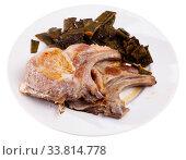 Купить «Delicious fried pork chops with stewed beans served», фото № 33814778, снято 31 мая 2020 г. (c) Яков Филимонов / Фотобанк Лори
