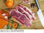 Купить «Raw pork's fillet shoulder with rosemary and garlic», фото № 33814810, снято 30 мая 2020 г. (c) Яков Филимонов / Фотобанк Лори