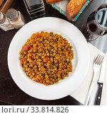 Купить «Appetizing stewed peas with ham», фото № 33814826, снято 2 июня 2020 г. (c) Яков Филимонов / Фотобанк Лори