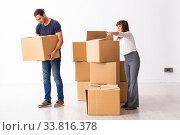 Купить «Young pair and many boxes in divorce settlement concept», фото № 33816378, снято 3 сентября 2019 г. (c) Elnur / Фотобанк Лори