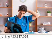 Купить «Young handsome doctor radiologyst working in clinic», фото № 33817054, снято 10 августа 2018 г. (c) Elnur / Фотобанк Лори