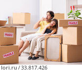 Купить «Young couple moving to new flat with fragile things», фото № 33817426, снято 5 июля 2018 г. (c) Elnur / Фотобанк Лори